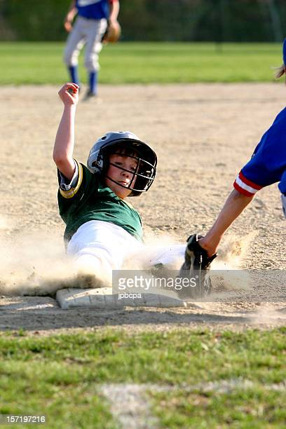 boy sliding into third