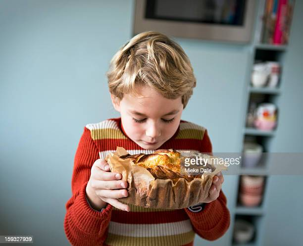 Boy smelling an apple cake he has made