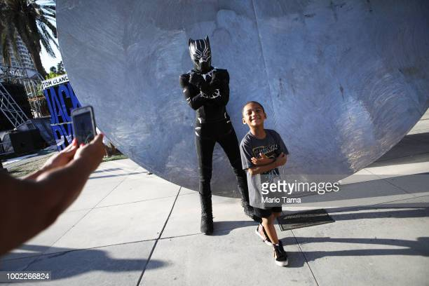 A boy smiles after posing with a cosplayer dressed as Black Panther outside San Diego ComicCon on July 19 2018 in San Diego California Thousands of...