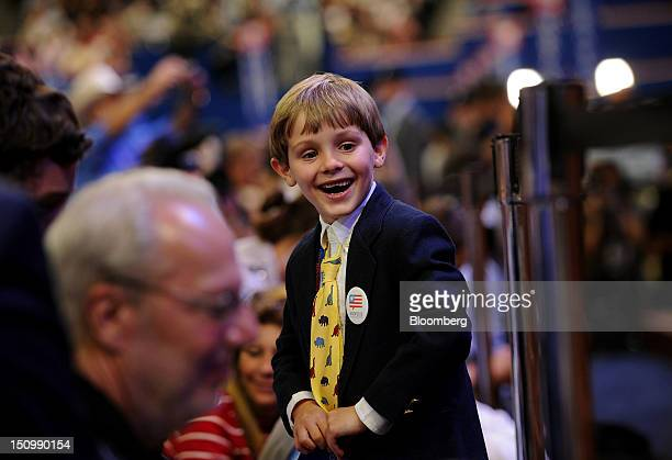 A boy smiles at the Republican National Convention in Tampa Florida US on Wednesday Aug 29 2012 Representative Paul Ryan takes the stage tonight to...
