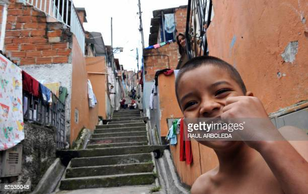 Boy smiles in the Pablo Escobar neighborhood -500 houses built by the Colombian drug lord for the poor- in Medellin, Antioquia department, Colombia...