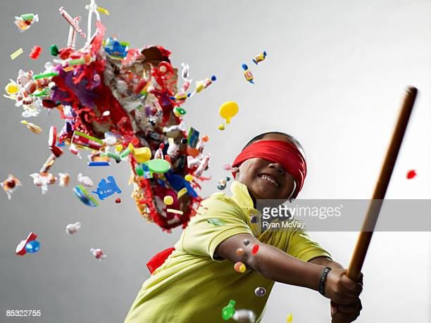 Boy smiling after hitting pinata