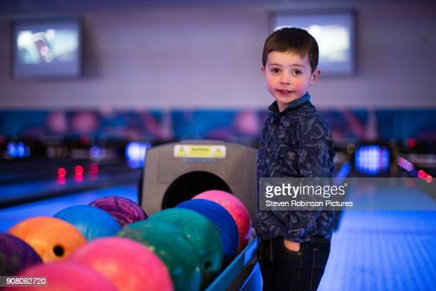 Boy Smiling at Bowling Alley