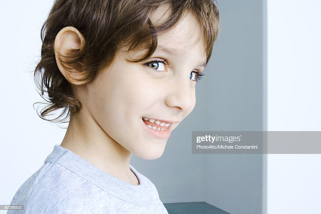 Boy smiling at camera, head and shoulders, portrait : Stock Photo