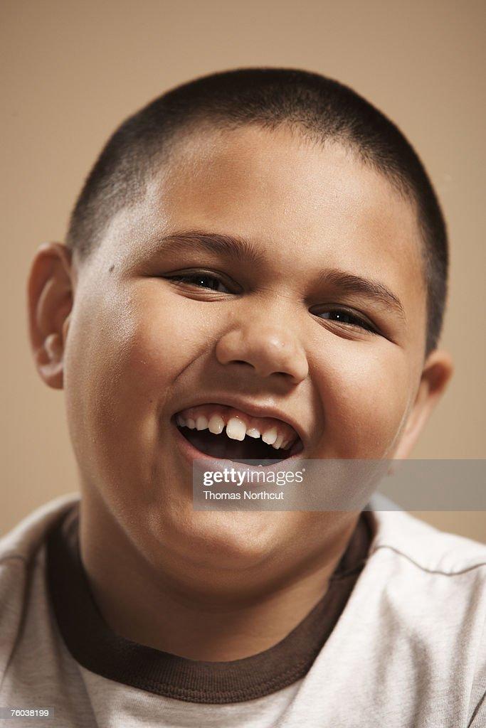 Boy (6-7) smiling, close-up, portrait : Stock Photo