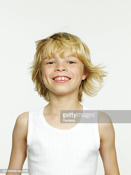 Boy (8-9) smiling, close-up, portrait