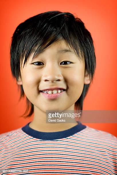 Boy (10-11) smiling, close-up, portrait