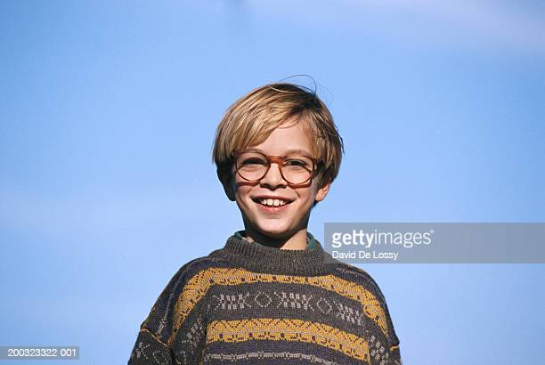 Boy (8-9) smiling, low angle view