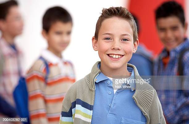 Boy (8-10) smiling, portrait, close-up