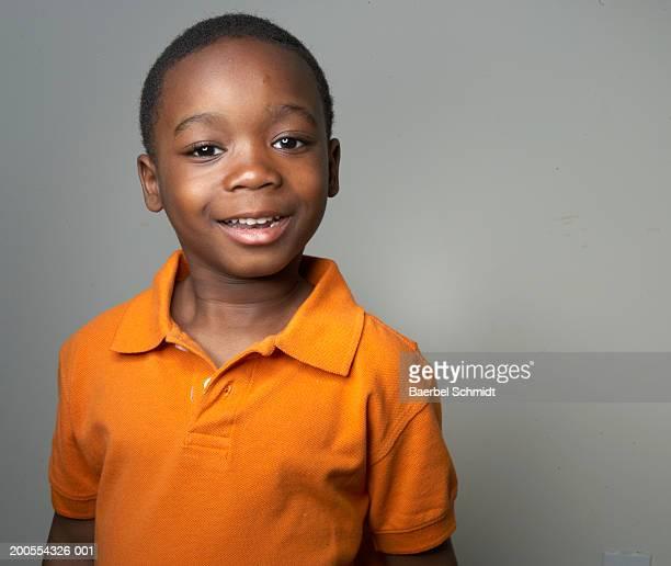 Boy (4-5) smiling, portrait, close-up