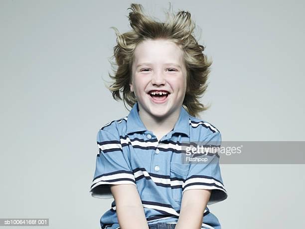 Boy (6-7) smiling, portrait, close-up
