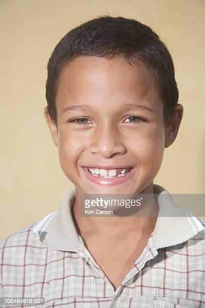 Boy (8-10) smiling, portrait