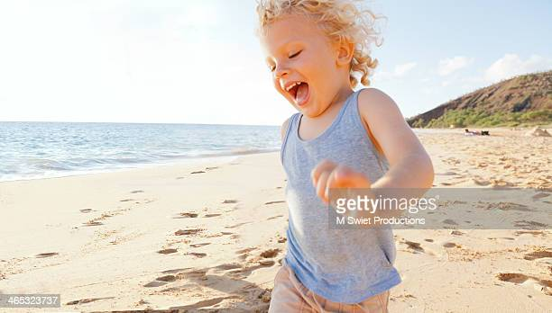 boy smiling running