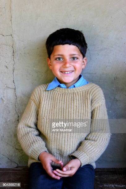 boy smiling while looking at the camera - amir mukhtar stock photos and pictures