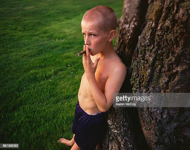 Boy smoking cigar