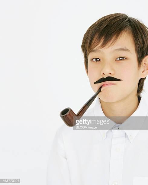 Boy Smoking Pipe