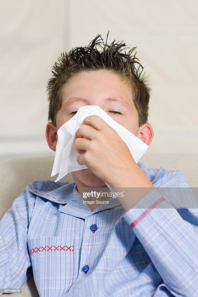 Boy sneezing : Stock Photo
