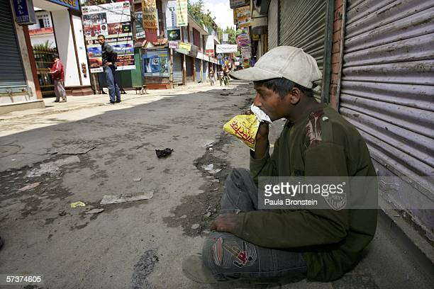 A boy sniffs glue from a bag on the quiet streets of the tourist area of Thamel in Kathmandu during an 18hour curfew as demonstrations against the...