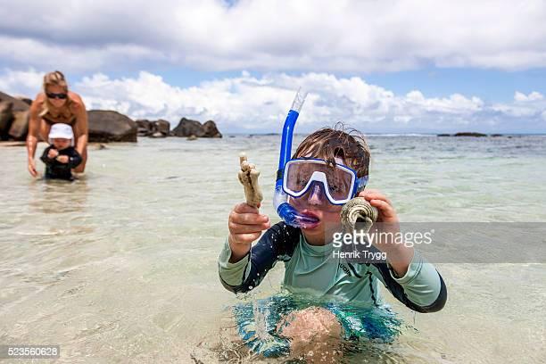 Boy snorkeling in Seychelles