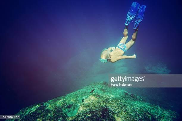 Boy snorkeling in the sea, underwater view
