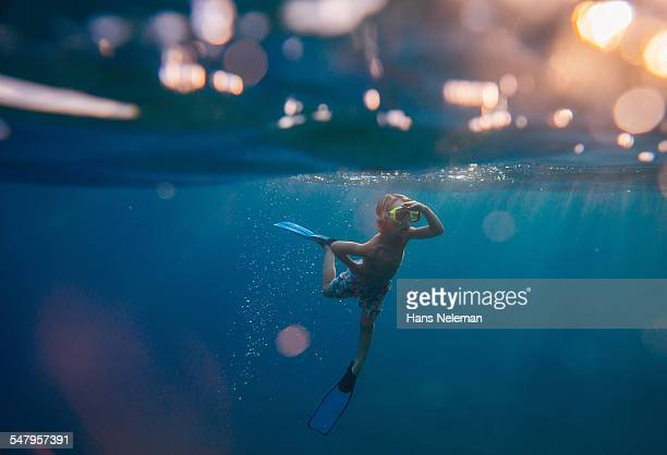 Boy snorkeling in the sea, underwater view