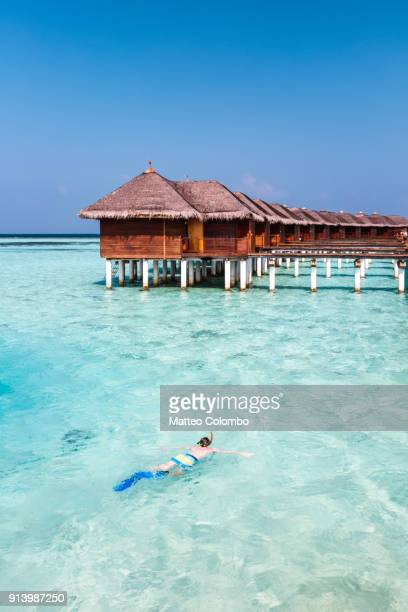 Boy snorkeling in the tropical sea, Maldives