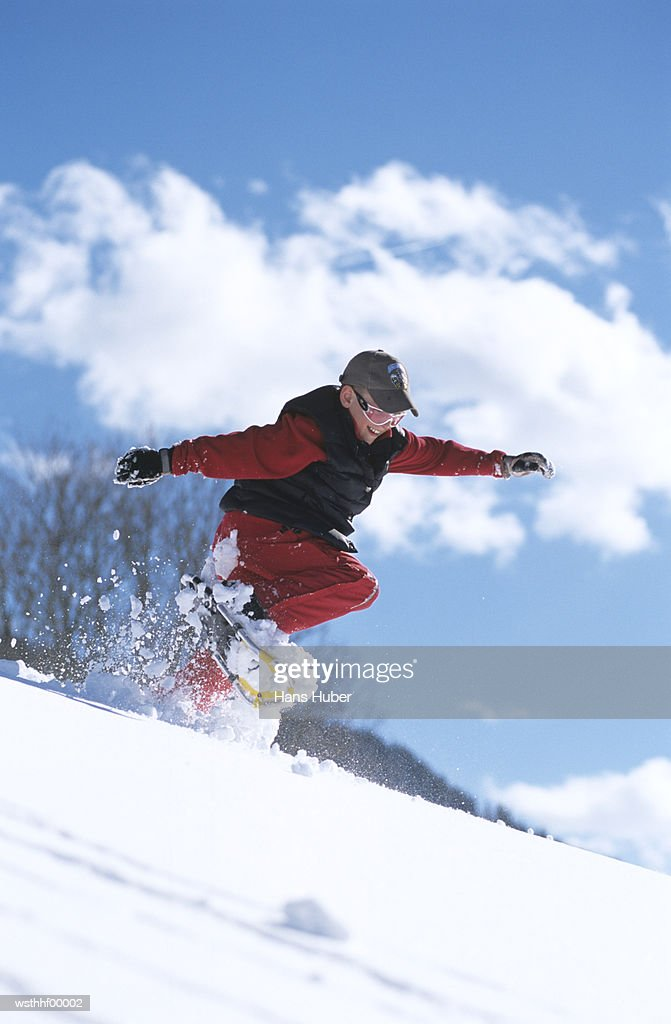 Boy snowboarding mid air : Foto de stock