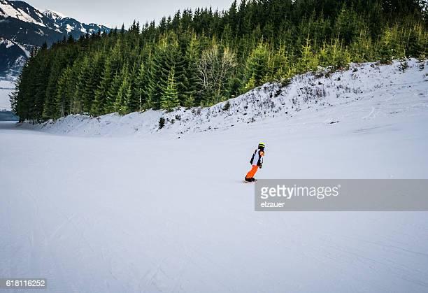 A boy snowboarding
