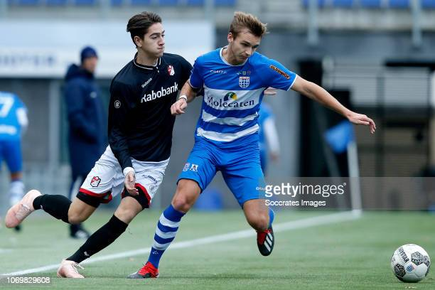 Boy Spijkerman of FC Emmen U19 Lars Miedema of PEC Zwolle U19 during the match between PEC Zwolle U19 v FC Emmen U19 at the MAC3PARK Stadion on...