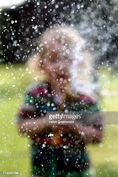 Boy spraying water.