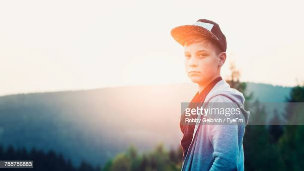 Boy Standing Against Clear Sky During Sunset