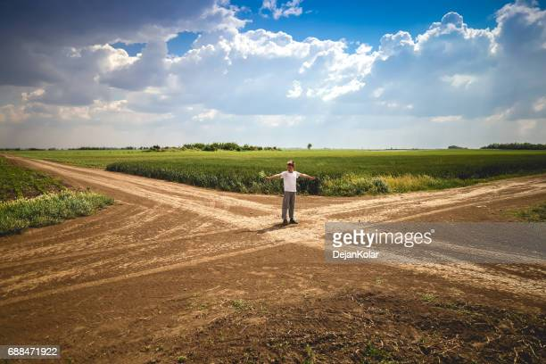 boy standing at crossroad in path - choice stock pictures, royalty-free photos & images