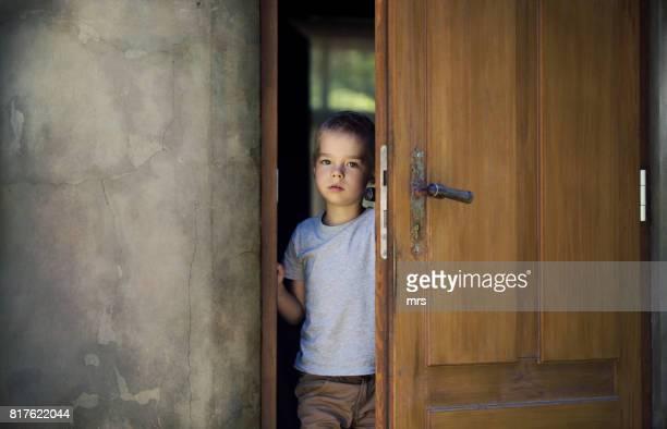 Boy standing at door