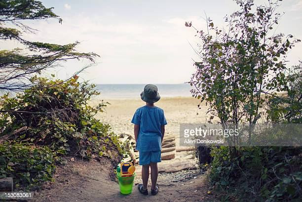 Boy standing at end of path