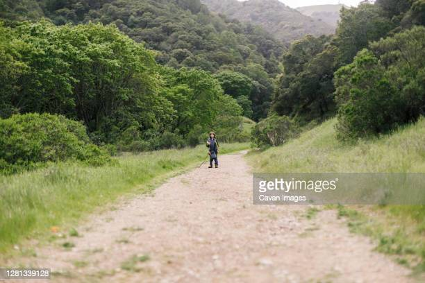 boy standing by trail in natural park - petaluma stock pictures, royalty-free photos & images