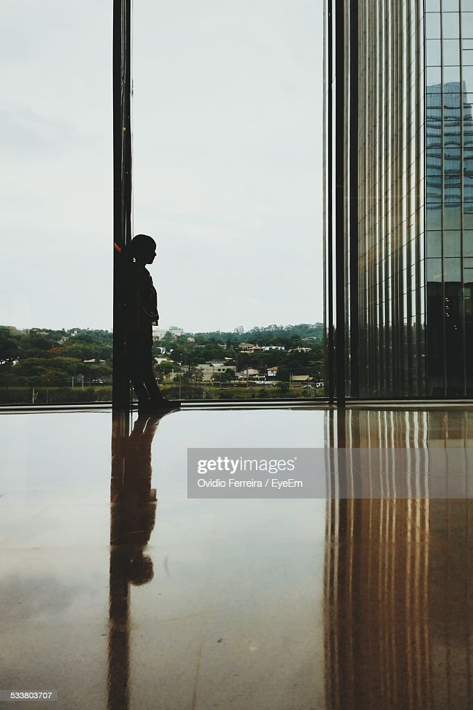 Boy Standing By Window In Apartment : Foto stock