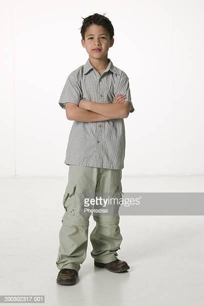 Boy (8-9) standing in empty room, portrait