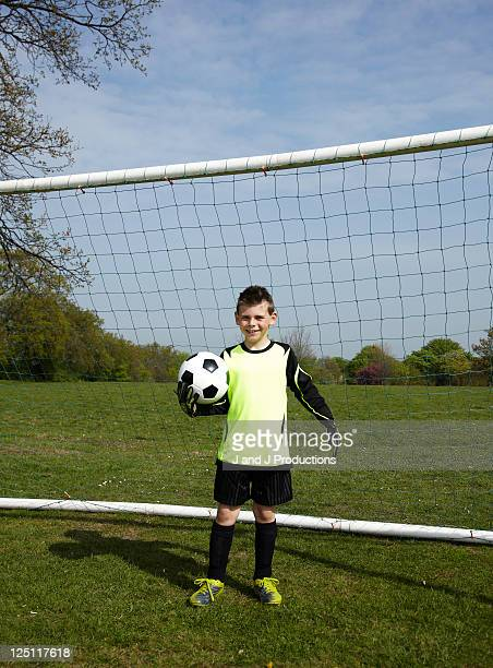 Boy standing in front of a goal
