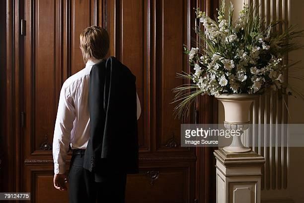 Boy standing in front of door