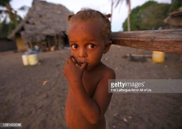 Boy standing in front of his house, Lamu County, Lamu, Kenya on February 26, 2011 in Lamu, Kenya.