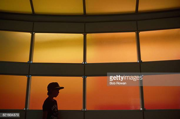 Boy Standing in Front of Sky's the Limit by Michael Hayden