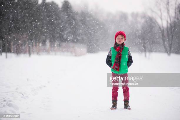 boy standing in the snow - warm clothing stock pictures, royalty-free photos & images