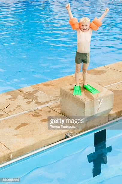 Boy standing on a starting block