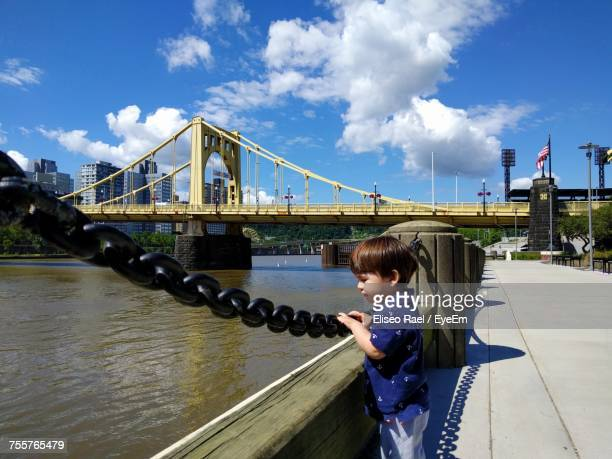 Boy Standing On Footpath By Roberto Clemente Bridge Over Allegheny River