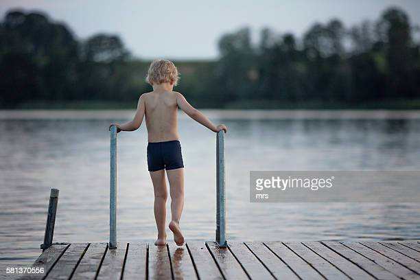 Boy standing on jetty