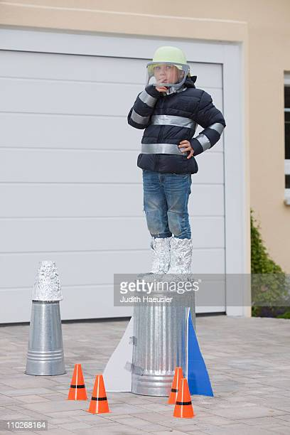 Boy standing on selfconstructed rocket