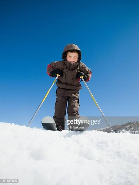 Boy standing on skis