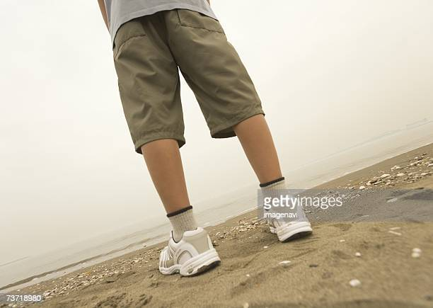 boy standing on the beach - boys bare bum stock photos and pictures