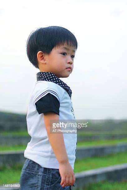 Boy standing outdoors