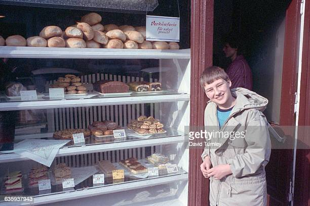 Boy Standing Outside Bakery